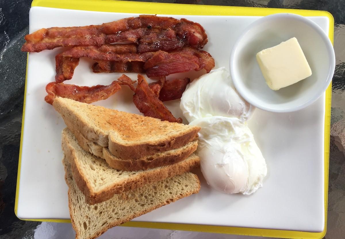 Poached eggs, bacon and toast Cafe Bar Carizma